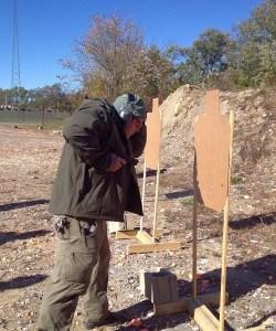 Demonstrating handgun retention shooting
