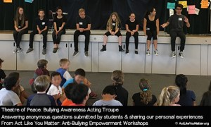 Photo of Theatre of Peace answering anonymous questions submitted by students at a school where we performed. Part of Act Like You Matter: Anti-Bullying Empowerment Workshops.