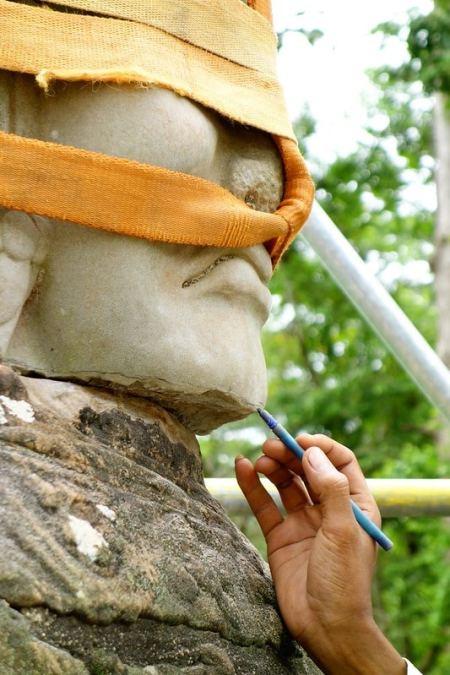 Renovating statue Angkor
