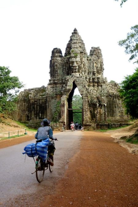 Bicycle riding towards entrance gate