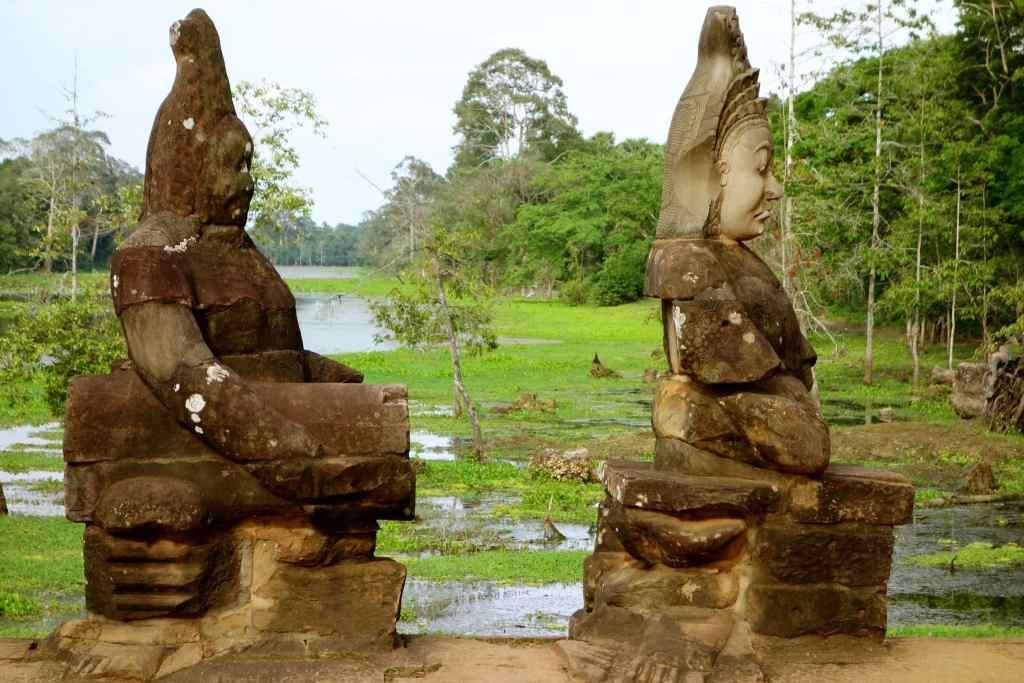 Two statues on bridge Angkor