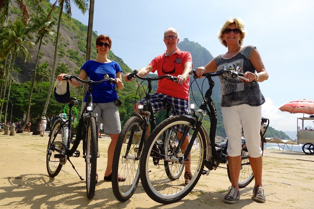 With bikes on beach Rio