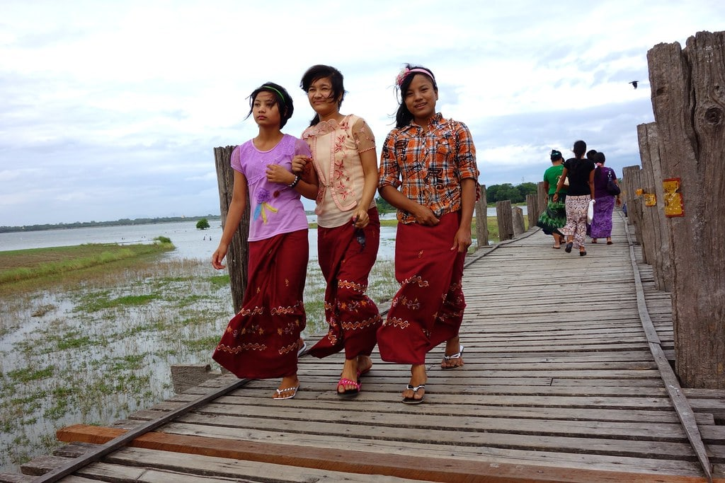 Locals walking a wooden bridge