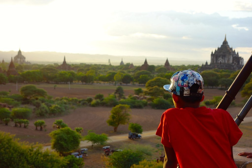Boy looking at sunset from temple in Bagan