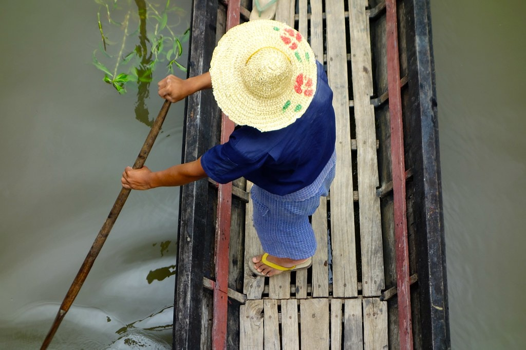 View from bridge on man in boat