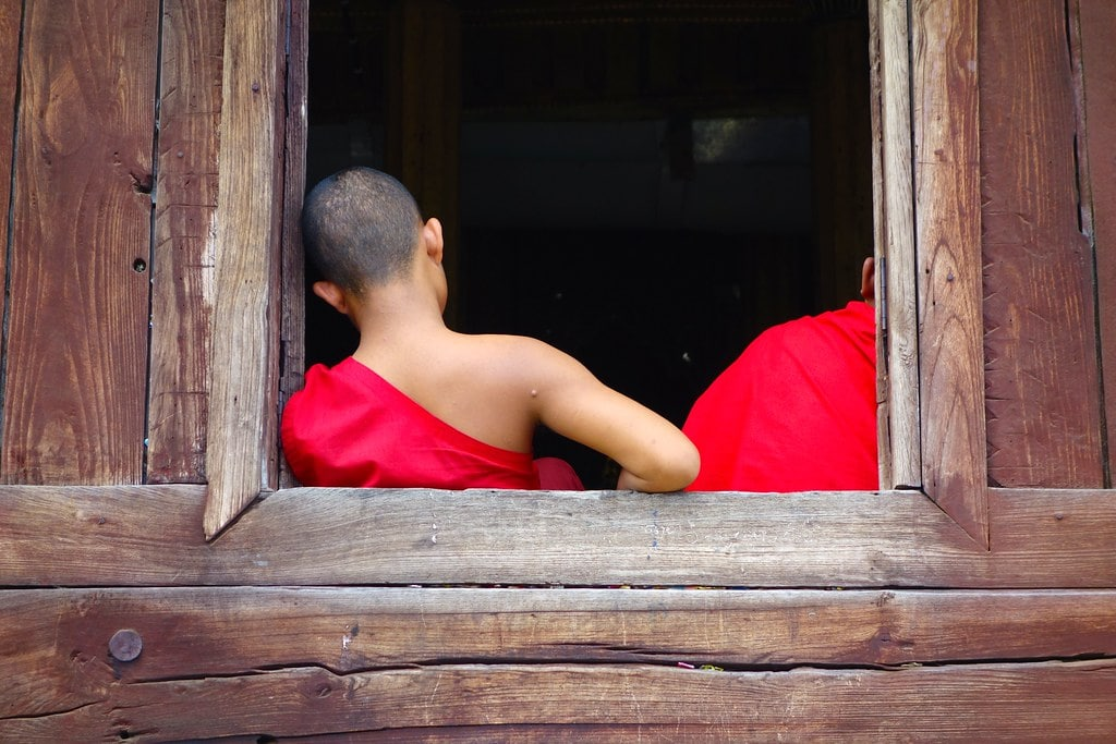 Monk leaning out of window