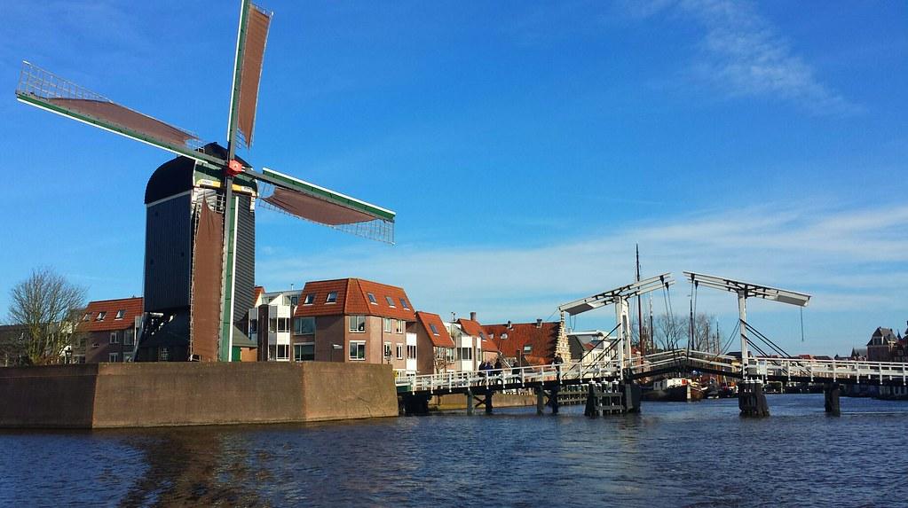 Canal windmill bridge Holland
