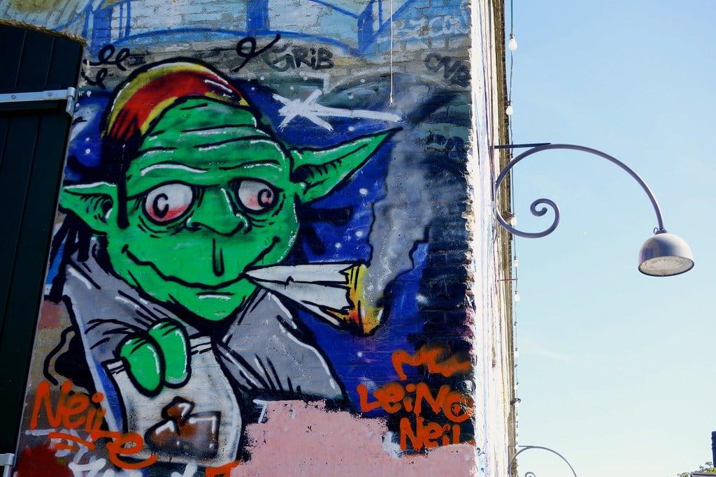 Street art Yoda smoking joint