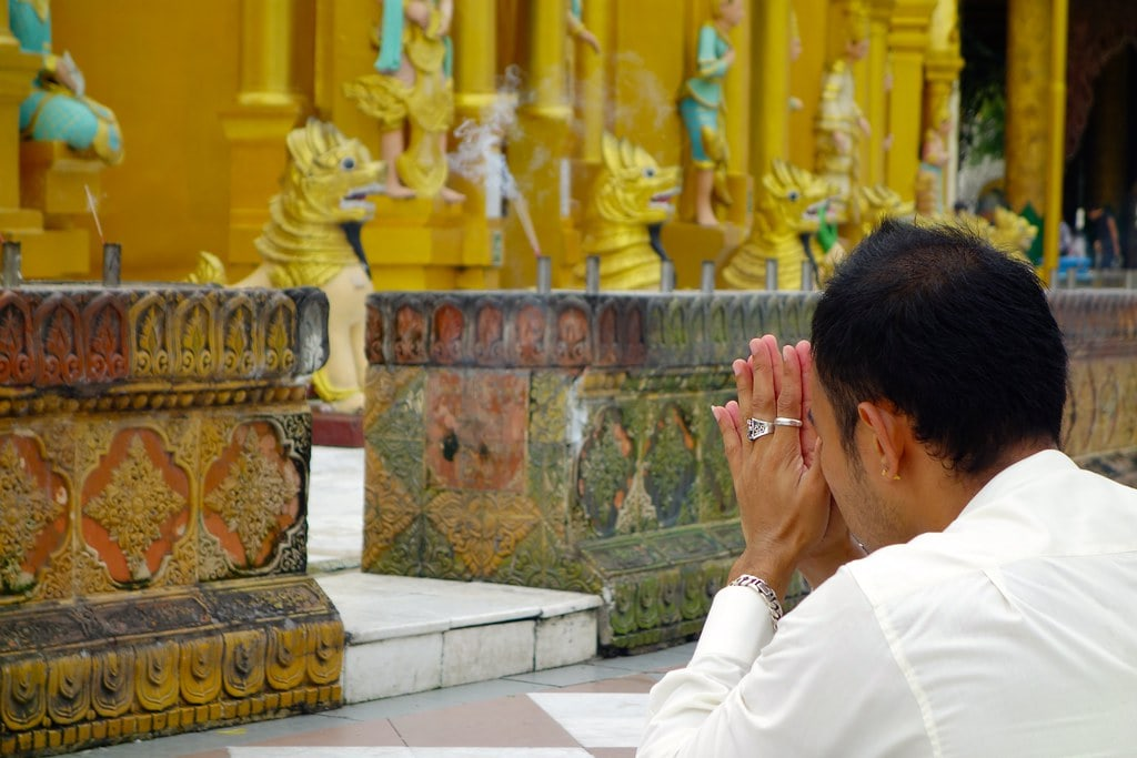 Man praying at Shwedagon pagoda