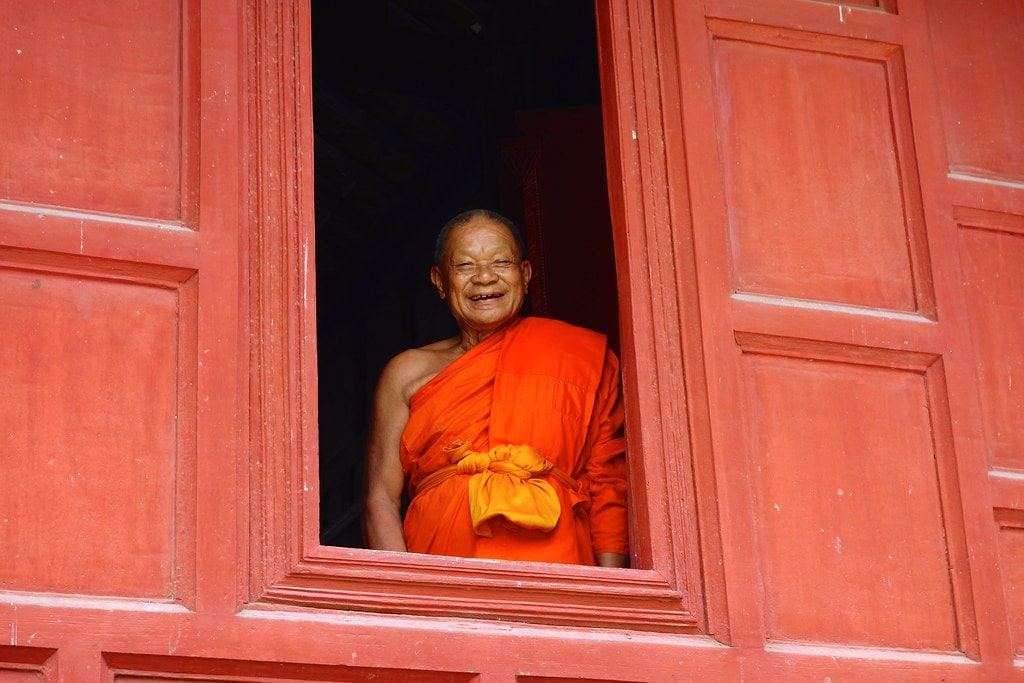 Monk smiling from temple window