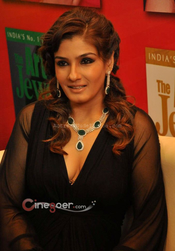 Raveena Tandon exposes hot deep cleavage in black dress