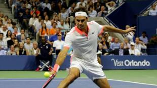 Roger Federer, of Switzerland, returns a shot to Stan Wawrinka, of Switzerland, during a semifinal match at the U.S. Open tennis tournament, Friday, Sept. 11, 2015, in New York. (AP Photo/Bill Kostroun)