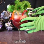 Sangria in glass with witchy hands