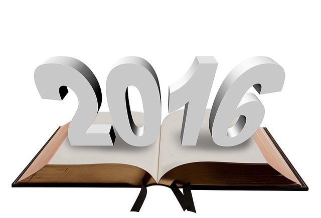 3d numerals 2016 over open book