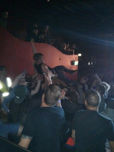 DJ Sizzle crowdsurfs at Seth Sentry's command at a gig in Sydney.