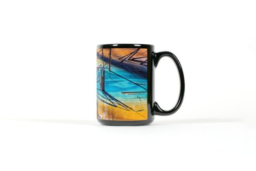 Center view of black mug with colorful reflections in a pond