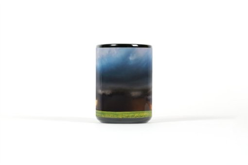 Center view of black mug with a supercell over a farmfield