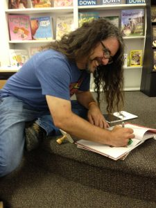 Signing some stock at Children's Book World in Haverford, PA on realease day.