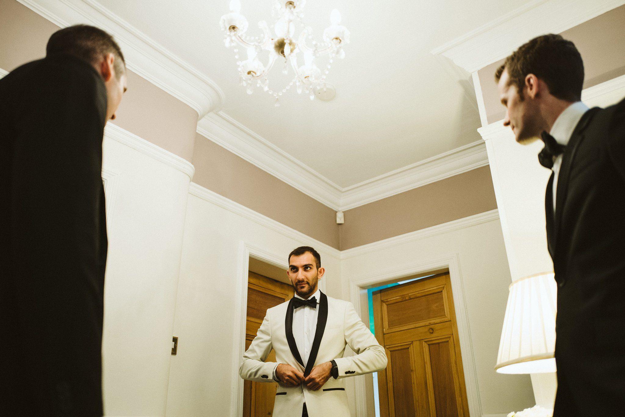 groom wedding day getting ready