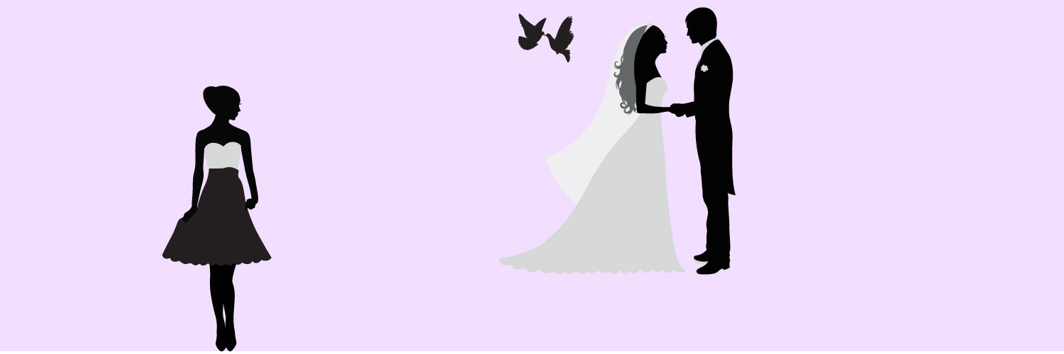 A wedding planner standing off to the side while she watches her clients get married with doves flying above them.
