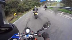 Video: Road Cyclist races Motorbike Riders down Mountain