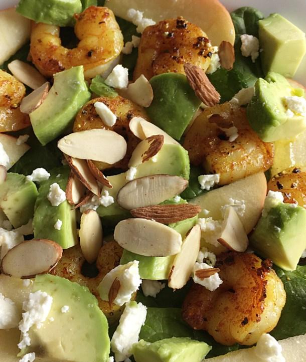 Turmeric Shrimp Spinach Salad with spinach, avocado, shrimp, feta cheese, and almond slices