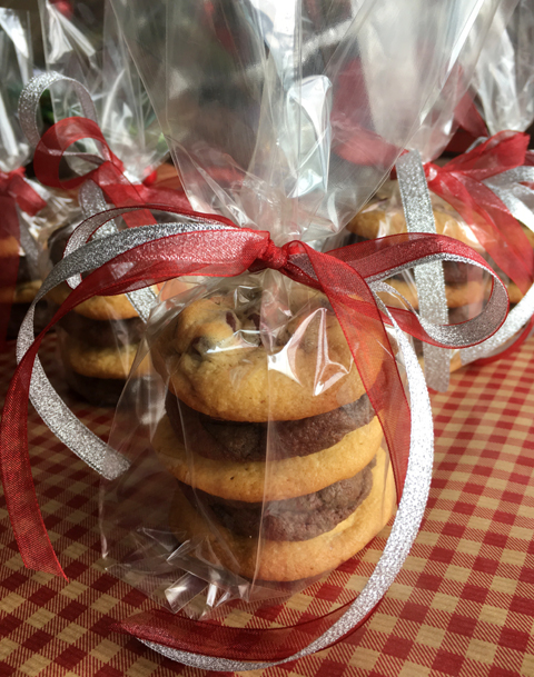 Classic Chewy Chocolate Chip Cookies and Chocolate Chocolate Chip Cookies wrapped in cellophane and ribbon
