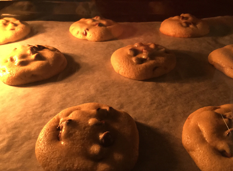 Classic Chewy Chocolate Chip Cookies baking in the oven