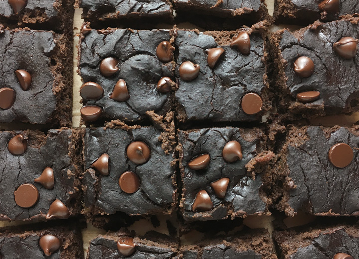 Close-up of squares of brownies topped with chocolate chips