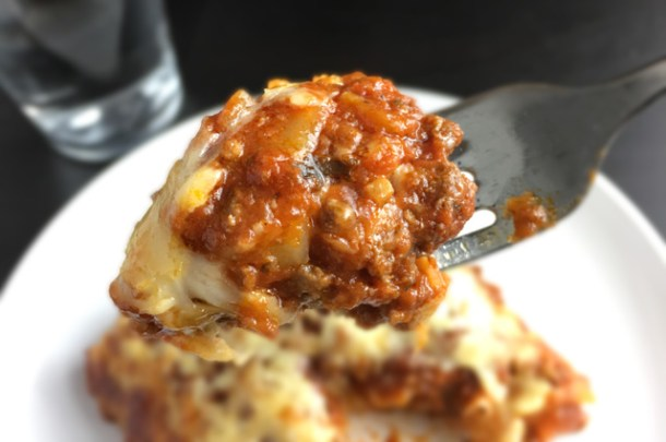 A forkful of Cheesy Bolognese Lasagna