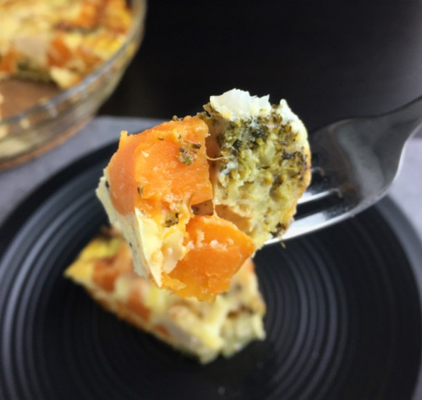 A forkful of sweet potato, broccoli and egg from Crustless Roasted Vegetable Quiche