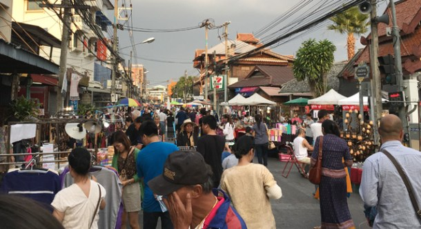 A crowd of people walking the street at the Saturday Night Market in Chiang Mai