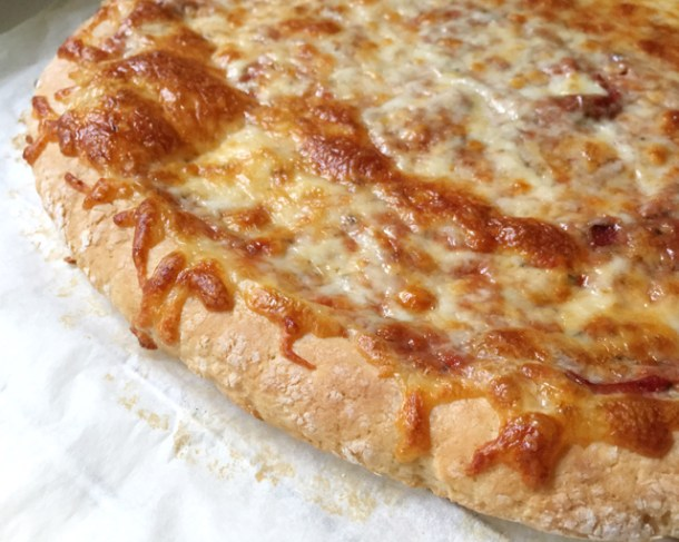 A baked cheese pizza using gluten-free pizza crust