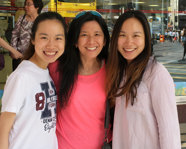 3 Asian ladies smiling at the camera, meeting food bloggers