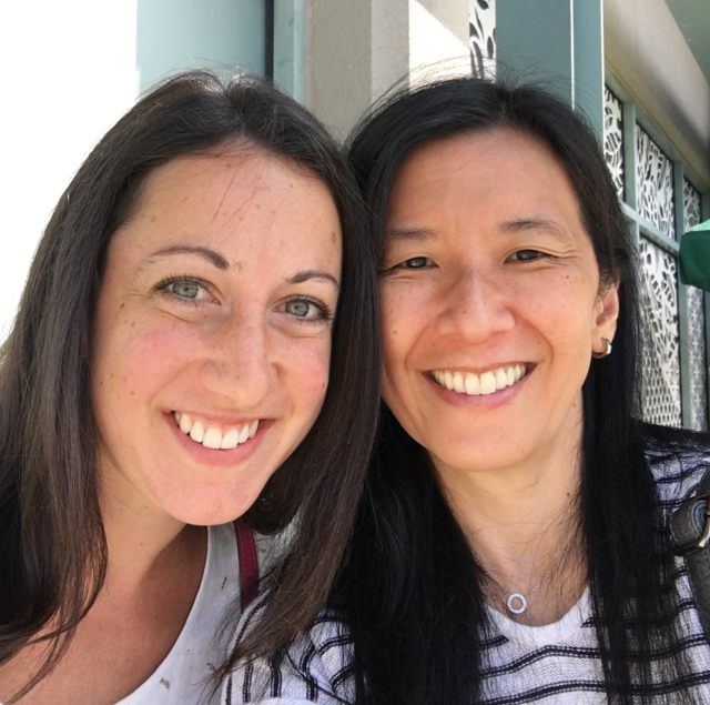 A Caucasian woman and an Asian woman, meeting food bloggers
