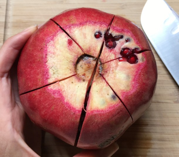 A pomegranate with score marks
