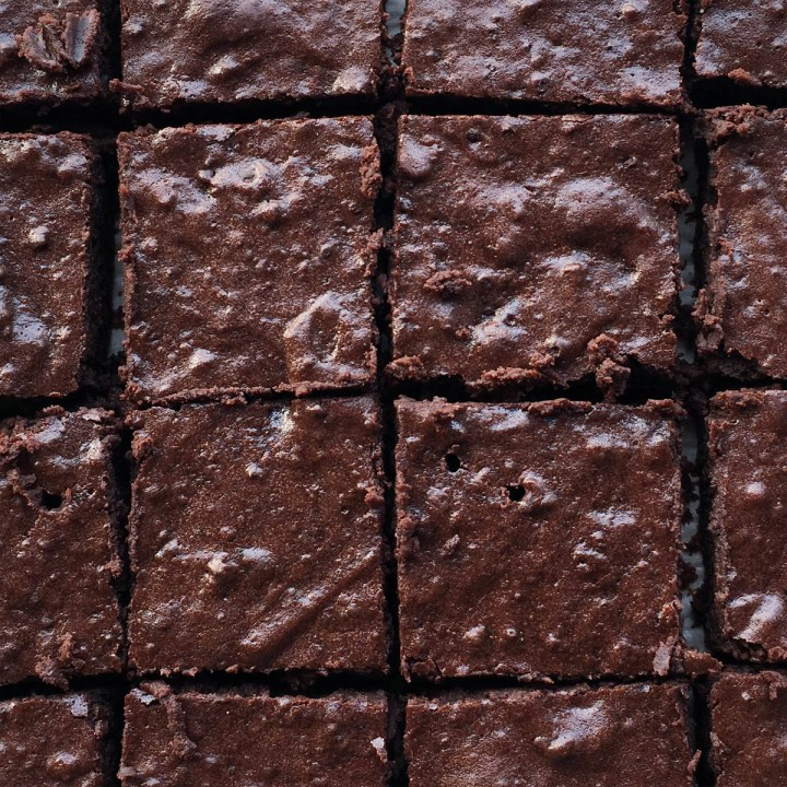 Looking down at several squares of chocolate brownies