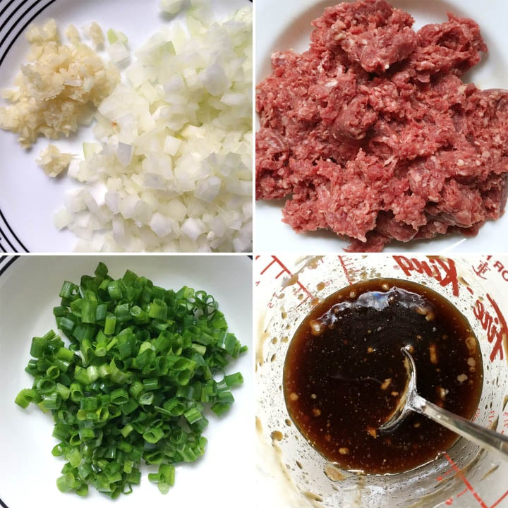 Chopped garlic, onion, green onion, red raw ground beef, and a measuring cup with brown sauce
