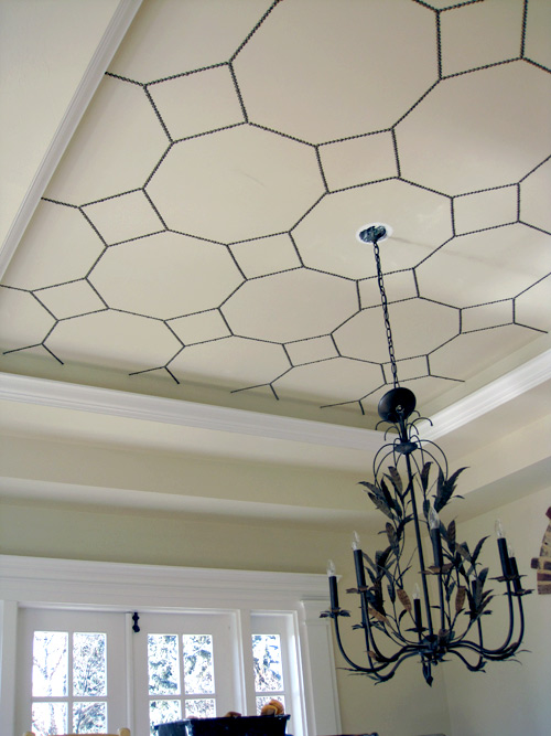 ceiling decorating ideas - nail head trim ceiling design, via Design Sponge