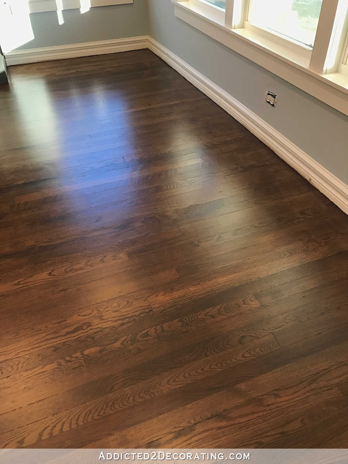oak wood floor living room leather furniture my newly refinished red hardwood floors addicted 2 decorating by the windows