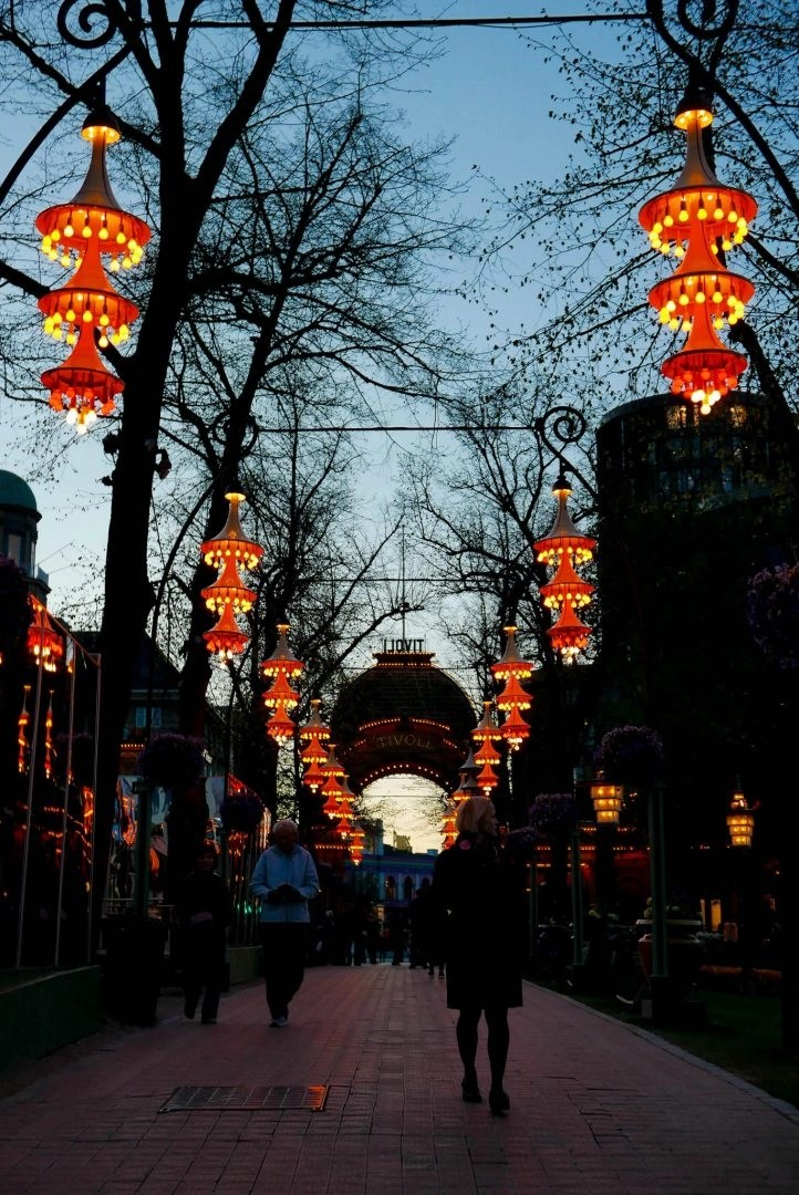 Spending time at Tivoli Gardens, the amusement park that inspired Disneyland is an absolute must while you're in Copenhagen. • What to do in Copenhagen