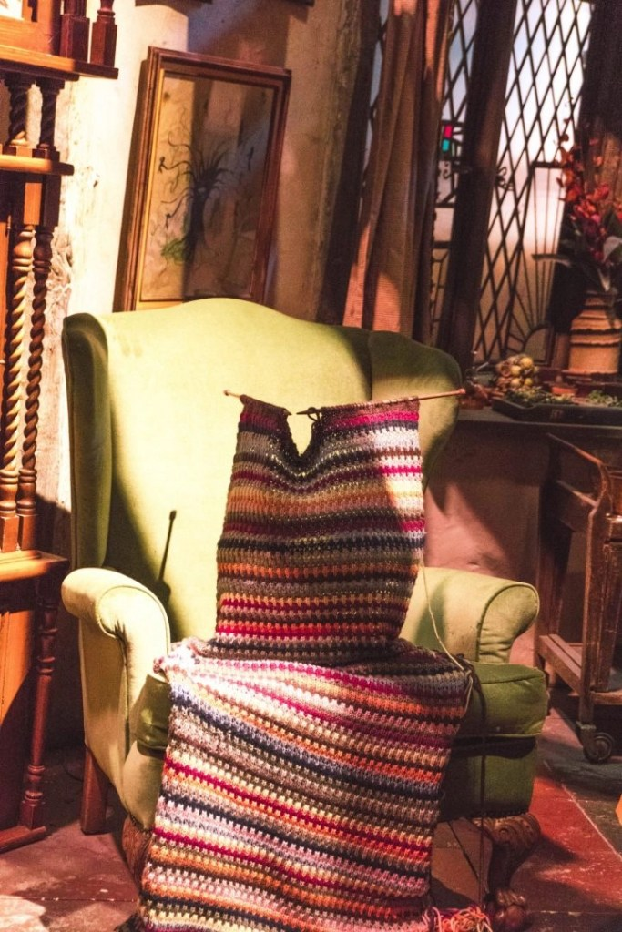 Mrs. Weasley's chair and knitting in the Burron, Warner Bros Harry Potter Studio Tour London