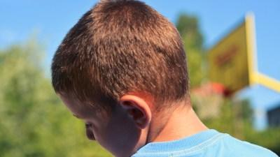 Sad ADHD boy outside