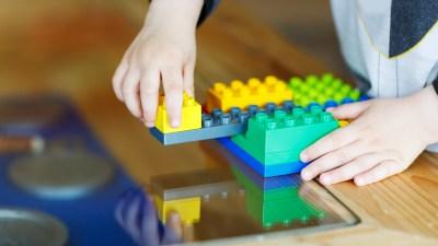ADHD boy playing with legos