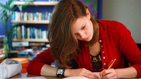 A young adult with ADHD studying for college using ADHD-friendly tips