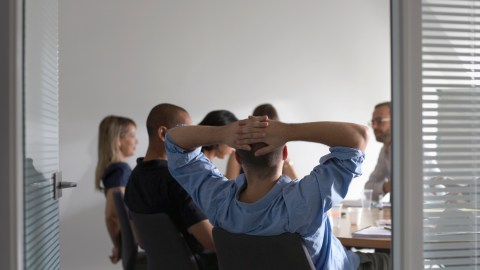 An employee stays focused and attentive at a meeting, helping to control symptoms of his ADHD in the workplace.