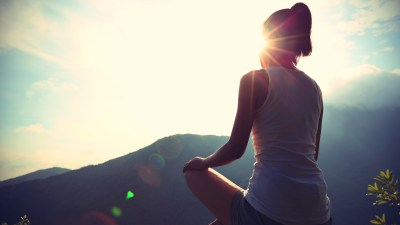 A woman does yoga to help her ADHD stress management.