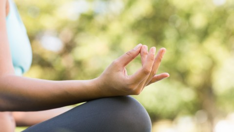 A woman meditating, which is a good way to treat adhd without medication.