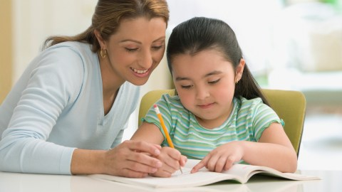 A mom and her daugther setting learning goals together before school starts.