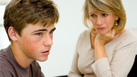 A mom sits with her son who has bipolar disorder that was misdiagnosed as ADHD.